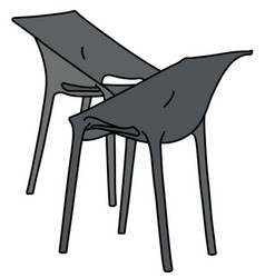 two black plastic simple chairs vector image