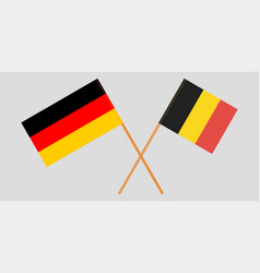 The crossed belgium and germany flags vector