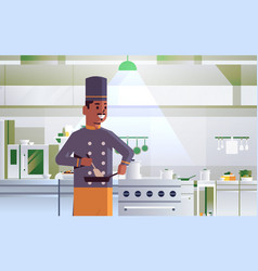 Male professional chef using frying pan stirring vector