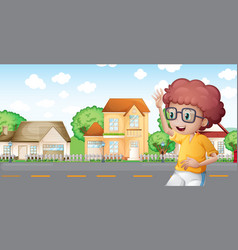 A boy jogging in front of the neighborhood vector