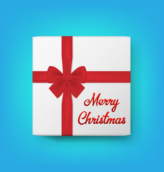 Realistic gift box and text merry christmas vector