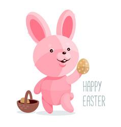 Easter bunny holding egg vector