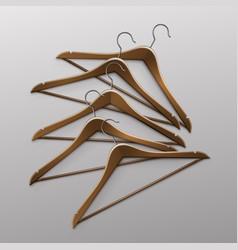 pile of lying clothes coat brown wooden hangers vector image