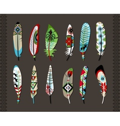 Feathers painted with colorful ethnic pattern vector