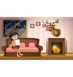 A girl studying inside the house near the vector