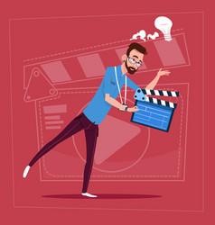man holding clapperboard modern video blogger vlog vector image vector image