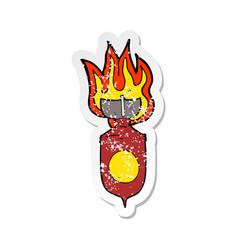 Retro distressed sticker a cartoon burning bomb vector