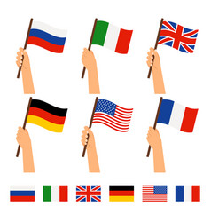 hands holding flags different countries vector image
