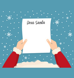 santa is holding in his hands reading a letter vector image
