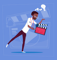 african american man holding clapperboard modern vector image
