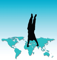 Man standing on his hands on the world map vector