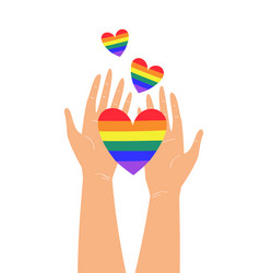 two hands holding lgbtq rainbow heart colors vector image