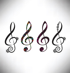 Four assorted decorative g clefs vector