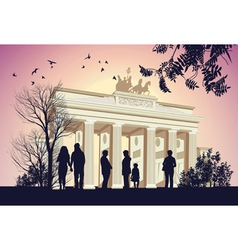 Group of people walking around the Brandenburger vector image vector image
