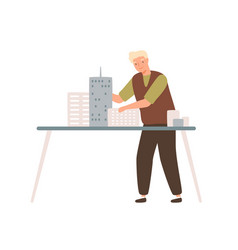 Young male architect install mini city building vector