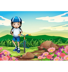 A young girl with bike standing near the rocky vector