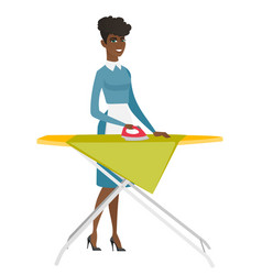 african maid ironing clothes on ironing board vector image
