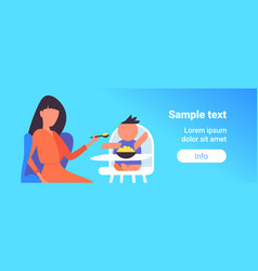 Mother feeds her little son with spoon baby vector