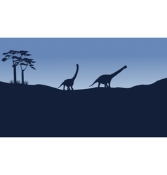 Silhouette of argentinosaurus on the hill vector