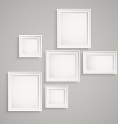 Different picture frames on the wall Place your vector image