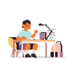 Little arab boy studying and doing school homework vector