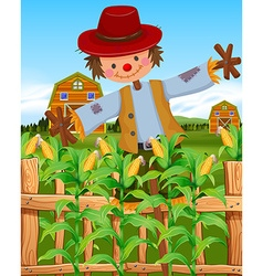 Scarecrow in the corn field vector