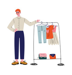 young man selling clothes at marketplace or flea vector image