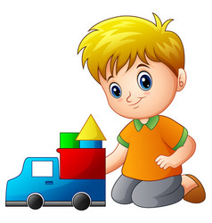 Little boy build a house out of blocks with toy tr vector