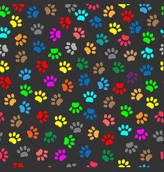colorful animal paw prints seamless pattern vector image