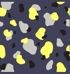 seamless pattern of yellow gray and black spots vector image