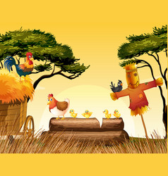 Chickens and scarecrow in the field vector