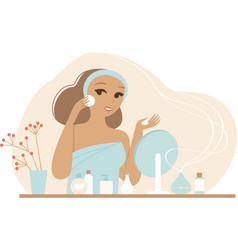 young woman cleaning her face vector image