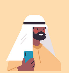 arabic man in traditional clothes using smartphone vector image