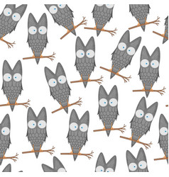 Seamless pattern of owls on a branch for kids vector