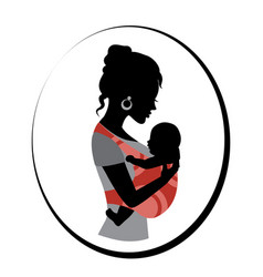 woman is holding a baby in a sling vector image vector image
