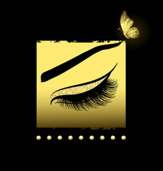 long lashes on a gold decorative background vector image