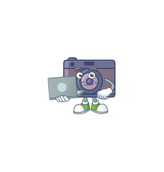 A smart retro camera icon working with laptop vector