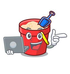 With laptop sand bucket character cartoon vector
