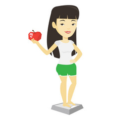 Woman standing on scale and holding apple in hand vector