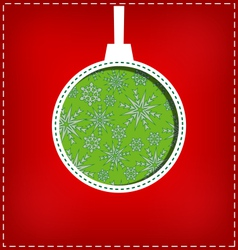 Christmas ball cutout on red vector