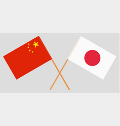 the crossed japan and china flags vector image