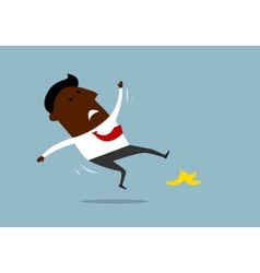 African american businessman slipping on a banana vector image