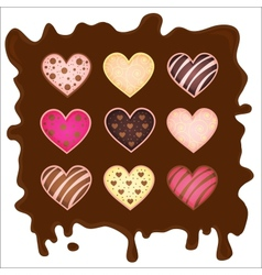 Set of the sweetmeats in form heart on chocolate vector