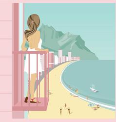 Woman on balcony of hotel looking at ocean coast vector