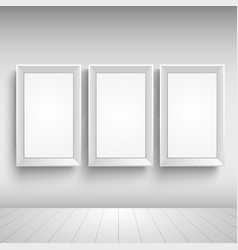 Three blank advertising signs on the wall template vector image