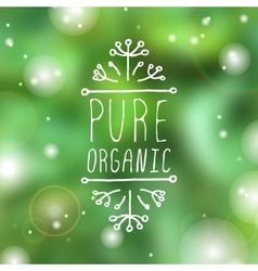 Pure organic - product label on blurred background vector image