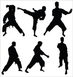 Karate pose silhouettes vector