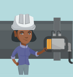 Operator checking the detector on the pipeline vector