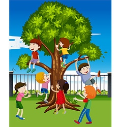 Children climbing the tree in the park vector image vector image