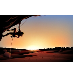 A sunset view of the desert with a man climbing at vector